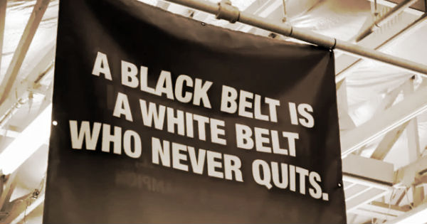 Jing Wu Warriors - A Black Belt is a White Belt Who Never Quits